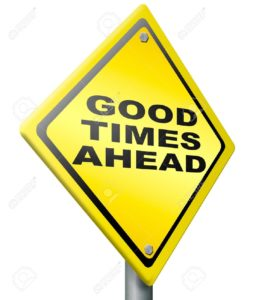 good-times-ahead-optimistic-yellow-road-sign-being-positive-and-optimism-for-a-bright-future-and-gre-Stock-Photo